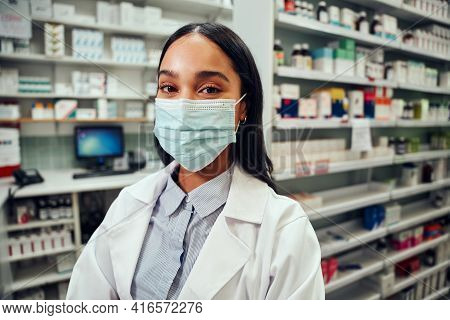 Portrait Of Young Woman Wearing Labcoat And Covid-19 Face Safety Mask Smiling Looking At Camera