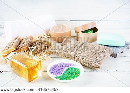 Different Spa And Bathroom Products Isolated On Wooden Background. Products For Beauty Treatments An