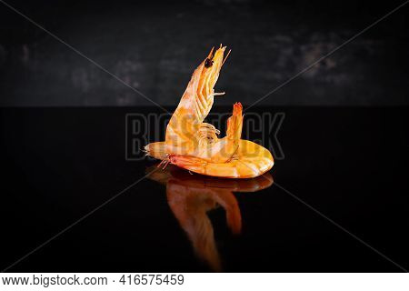Delicious Cooked Shrimps Isolated On Dark Background. Boiled Prawns