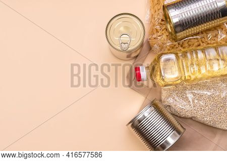 Paper Bag With Food Supplies Crisis Food Supply On A Light Yellow Background, Copy Space. Pearl Barl