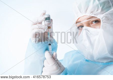 No Logos Or Trademarks!  Self Made Labels!  View Of Doctor With An Ampule Of Covid Vaccine And Syrin