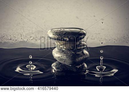 Zen Stones In The Water With Splashing Drops. Horizontal Image.