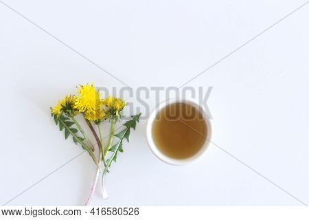 Yellow Spring Flower And Cup Of Tea. Dandelion Isolated On White Background. Card With Space For You