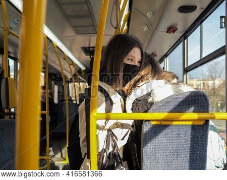 Moscow. Russia. April 12, 2021. Two Cheerful Girls In Protective Masks In A City Bus Laugh And Hug.