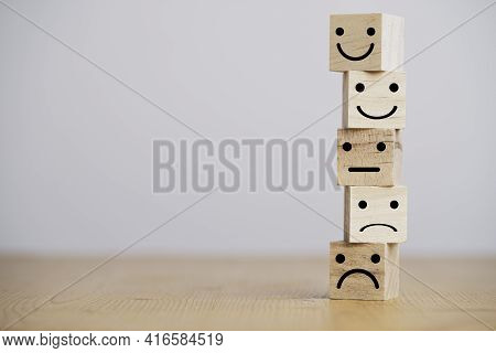 Customer Satisfaction Survey Concept, Human Face Icons Print Screen On Wooden Cube Block On Table Fo