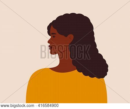 Young African American Woman. Portrait Of A Beautiful Black Woman With Curly Hair.side-view.modern V