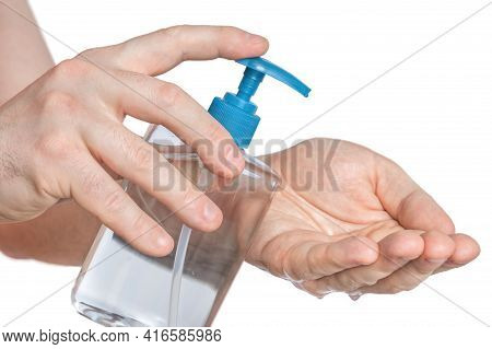 Man Is Applying Antibacterial Gel, Sanitiser On His Hands - Hygiene Concept