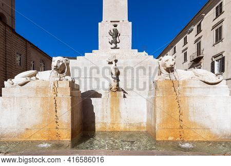 View The Famous Obelisk Fountain On Square (piazza Federico Ii) In Jesi Town. Marche, Italy