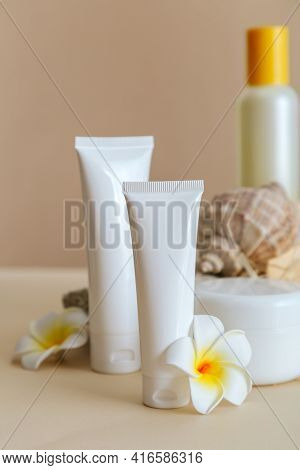 Natural Beauty Cosmetic Tube Mockup Product For Skincare With Sea Shell Tropical Plumeria Flowers On