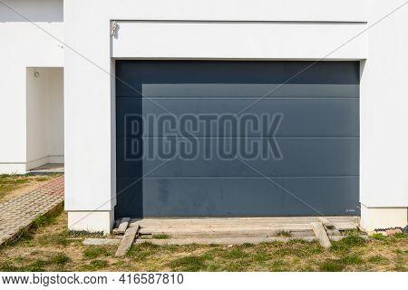 Modern Door Garage In Contemporary House. House Under Construction. Europe