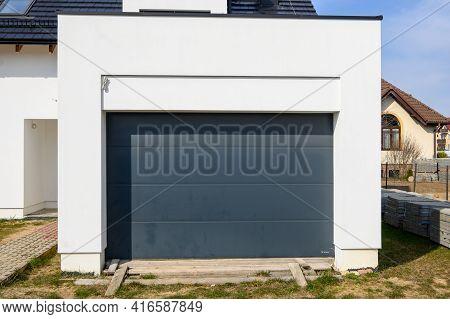 Gdansk, Poland - April 11, 2021: Modern Door Garage In Contemporary House. House Under Construction.