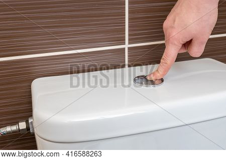 Hand Of Woman Flush Toilet After Using - Hygiene Concept