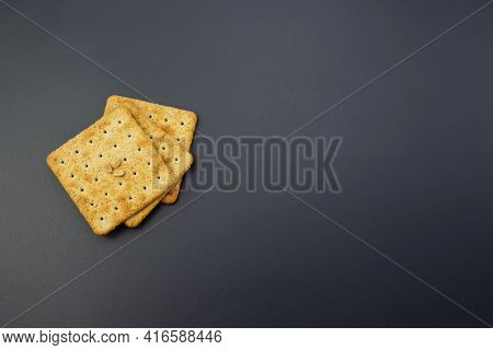 Square Crackers On A Gray Background. Mouth-watering Wheat Flour Crackers