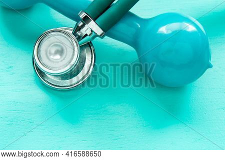 Stethoscope And Weight For Physical Exercise Symbolizing Mental Balance