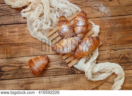 French Fresh Crusty Croissants On A Wooden Table Top View