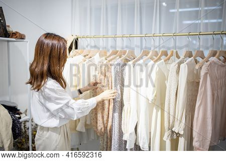 Portrait Of Happy Female Asian Entrepreneur Working In Her Modern Store With Womenswear Clothes, You