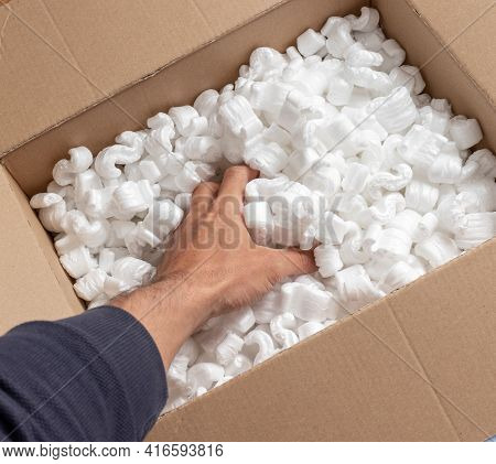 A Cardboard Box With Packing Styro Foam Pellets Top View