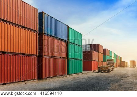 Container Stacking Cargo With  Trailer Transport Truck Working In Shipping Harbor. Logistics Export