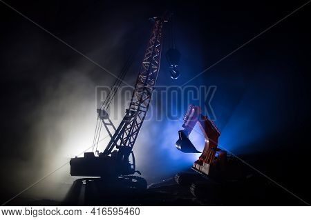 Abstract Industrial Background With Construction Crane Silhouette Over Amazing Night Sky With Fog An