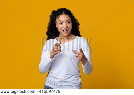 Hey You. Cheerful Young Black Lady Pointing Fingers At Camera