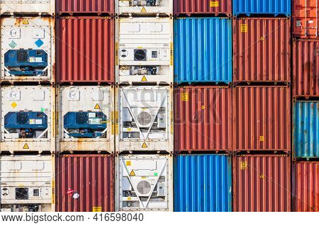 Stacked Freight Shipping Containers And Refrigerators Photo Background Texture
