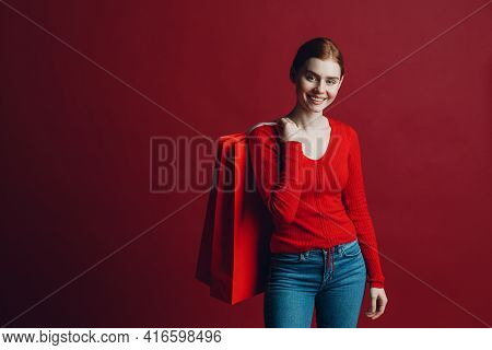 Pretty Woman Smilng Portrait With Paper Red Shopping Bags. Black Friday And Sale.