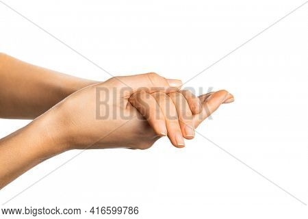 Close up of female hands rubbing against each other while applying lotion over white background. Side view of young woman applying moisturizer cream or hand sanitizer isolated on white background.