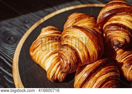 Fresh Baked Croissants. Warm Fragrant Butter Croissants And Rolls On A Stone Stand. French And Ameri