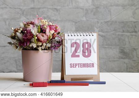 September 28. 28-th Day Of The Month, Calendar Date.a Delicate Bouquet Of Flowers In A Pink Vase, Tw