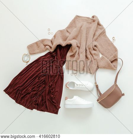 Female Spring Look Autumn Outfit Burgundy Skirt Beige Sweater White Shoes Sneakers Bag. Folded Fly C