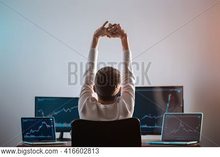 Relaxed Successful Male Trader Resting With Stock Exchange Graph Or Chart