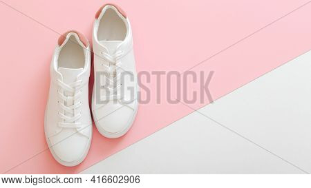 White Sneakers, Female White Leather Shoes With Laces On Pink Background. Pair Of Stylish Sneakers C