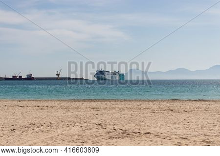 Mallorca, Spain - March, 2021: Balearia Ferry Ship Arriving In Port Of Alcudia In Mallorca During Co