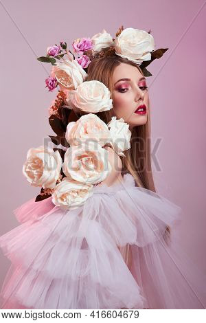 Beauty Woman Bright Red Makeup, Rose Flowers On Head Woman. Art Girl In A Transparent Light Dress On