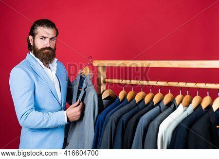Well Groomed Man In Wedding Formalwear Has Beard Choose Jacket In Wardrobe, Atelier
