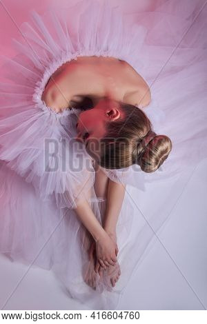Beauty Woman Bright Red Makeup Sits On The Floor. Art Girl In A Transparent Light Dress On A Pink Ba