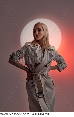 Art Portrait Woman In Raincoat Glowing Circle. Blurry Out Of Focus Face Of A Woman. Contrast Light M