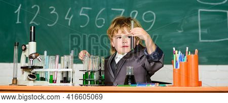 Kid In Lab Coat Learning Chemistry Little Kid Learning Chemistry In School Lab . Little Boy At Chemi