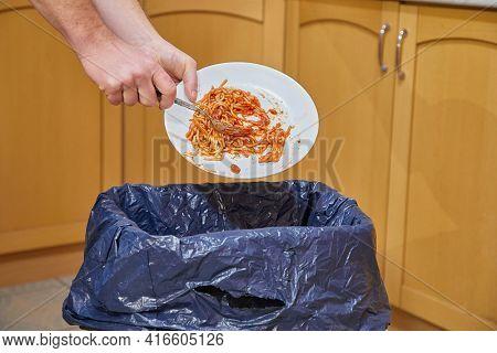 Food leftower thrown in the kitchen garbage bin, food waste problem
