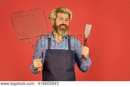 Fried On Grill. Mature Chef Use Cooking Utensils For Barbecue. Tools For Roasting Meat. Who Cook Bet