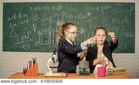 In Search Of Right Medical Solution. Little Scientist Work With Microscope. Little Girls In Lab. Che