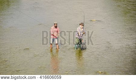 Gone Fishing. Hobby And Sport Activity. Trout Bait. Two Happy Fisherman With Fishing Rod And Net. Fa