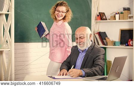 Educational Activity. Educator And Student Classroom. Girl With Notepad Near Chalkboard. High School