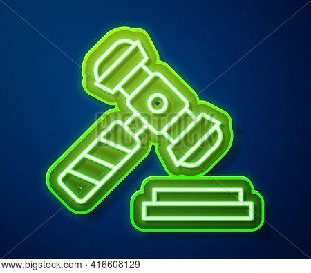 Glowing Neon Line Judge Gavel Icon Isolated On Blue Background. Gavel For Adjudication Of Sentences