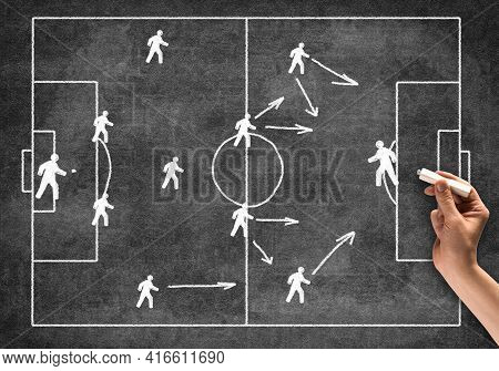 Businessman Hand With Chalk Draws Scheme Of Game. Freehand Illustration On Blackboard. Planning Stra