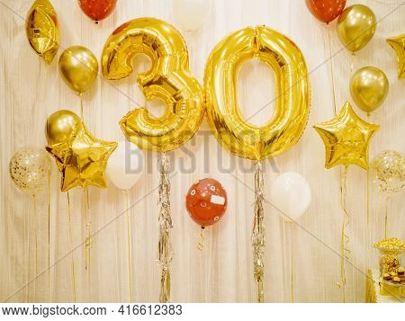 A Bright Composition Of Helium Balloons Of Gold And White Colors And A Large Figure Of Thirty Gold F