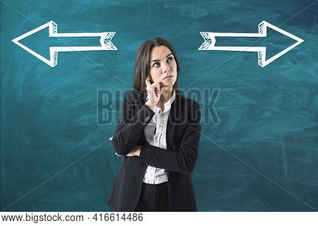 Businesswoman Standing Thinking Back Facing The Green Background With White Silhoette Arrows, Choice