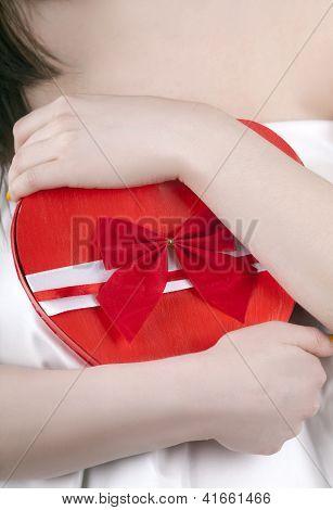 A Heart Shape Box In A Girls Heands