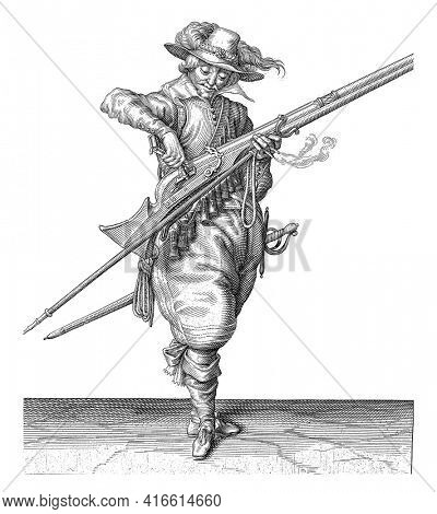A Soldier, Full-Length Pour powder from a powder bottle into the pan (the powder container) of a musket (a certain type of firearm), vintage engraving.