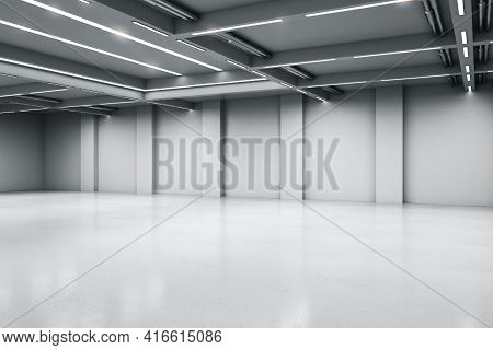 Empty Big White Room With Concrete Floor And Walls, Artificially Lighted, Showroom And Exhibition In
